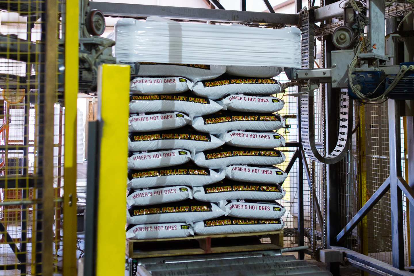 Bags of Hamer's Hot ones being stacked